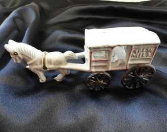 Cast iron milk wagon.