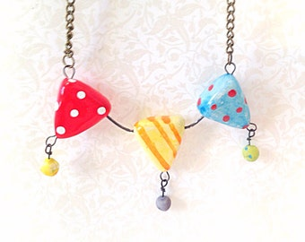 Ceramic Colorful Bunting Necklace. Glazed Ceramic. Circus. Party. Summer. Sweet. Whimsical. Vintage Style Brass Chain. Polka Dot. Red. Blue