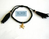 Bracelet No. 057 Black bracelet with golden skull and tassels
