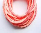 Knitted Tube scarf in grapefruit and light peach