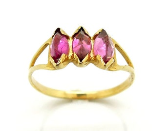 Pink tourmaline set in a gold engagement ring