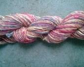 Handspun Yarn: Single Ply in Berries and Cream.