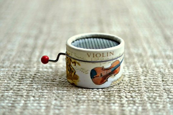 Music box Violin. Paper.