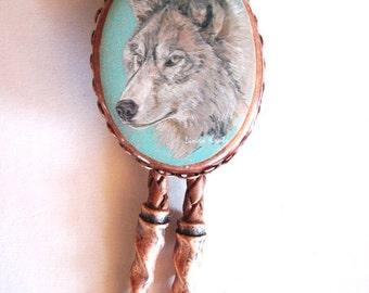 Classic western grey wolf copper bolo tie
