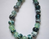 SRA handmade glassbeads, set of 22 beads in various design,in green, made by me