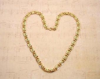 """1990 Avon """"Golden Swirl"""" gold tone necklace"""