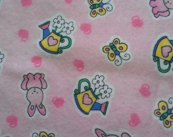 Pink with Bunnies,Flowers,Butterflies Flannel Fabric BTY