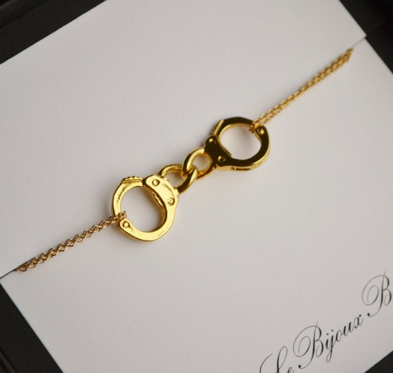 items similar to partners in crime gold cuff