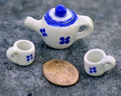 Porcelain Miniature Tea Set Featuring a Teapot and 2 Mugs