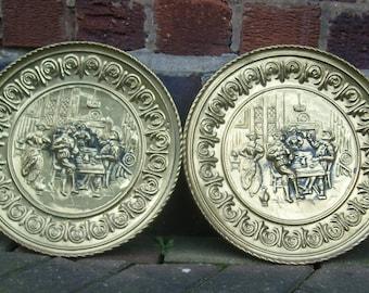 Vintage Brass wall plates embossed tavern scene