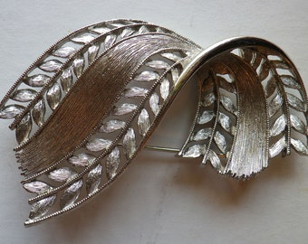 Silvertoned Brooch with Copyright J J