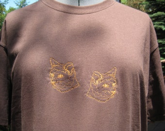 Golden kitties embroidered onto a chocolate brown XL Tshirt