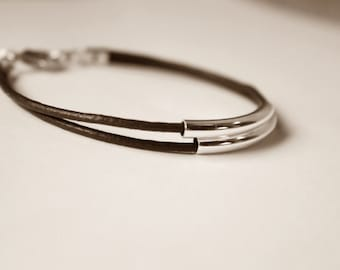 Leather bracelet with silver tubes, two strands