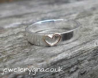 18ct Gold heart silver ring. Sterling silver ring set with gleaming 18ct gold heart. Silver band with gold heart.