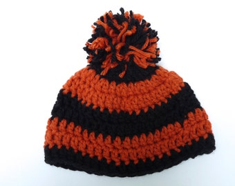 Baby halloween orange and black striped hat  hand crocheted with orange and black pom pom
