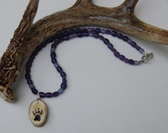 Hand carved bear paw print deer antler pendant on purple glass beaded necklace, unique gift, nature jewelry, birthday gift.