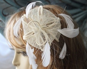 Very  cute   ivory color   flowers clip with feather