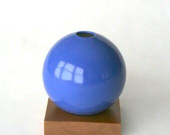 delphinium blue ceramic vase and cherry wood base