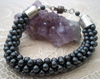 Hematite Kumihimo Bracelet With Siver Tone Ends & Black Magnetic Clasp