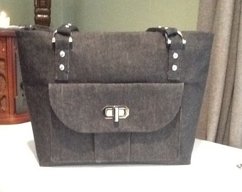 Black Denim purse, outside pocket with twist lock closure and silver studs