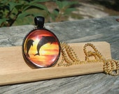 Sunset Dolphins Round Domed Glass Pendant Necklace