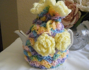Cute, pastel colored crochet tea cozy with yellow roses..
