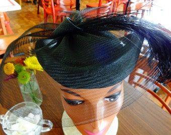 Black straw hat with sequin band, netting, feathers