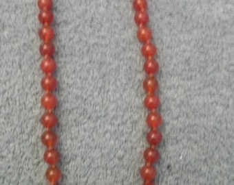 SALE!  Knotted carnelian bead necklace from 1980s
