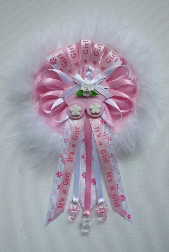pink baby shower mommy corsage with carriage centerpiece and fluffy