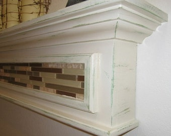 white distressed shelf or fireplace mantel by