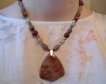 Colors of fall necklace:  Natural grey jasper, jade, iron pyrite, mookaite and nipomo coral fossil .925 sterling silver necklace