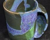 Green and purple handwarmer mug