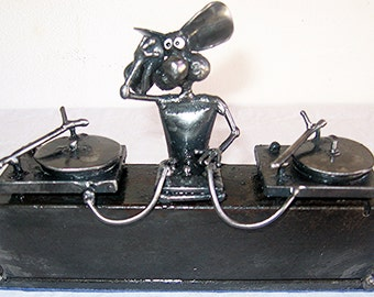 DJ Mouse Sculpture made from recycled steel.