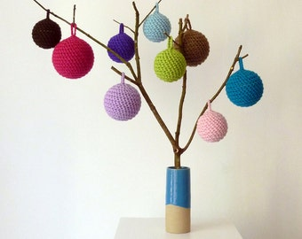 Hand-crocheted Christmas tree decoration in soft wool