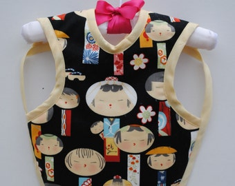 Bib for infants up to 18 months.  Designer cotton fabric with minky backing.