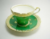 Antique Aynsley  Kelly Green gold rim Cup And Saucer.