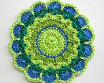 Handmade crocheted flower motif applique in blue and green shades  3,5 inches wide