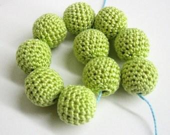 Crocheted beads 20 mm light midori green handmade round cotton on wood