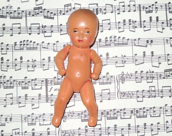 Mini old plastic doll