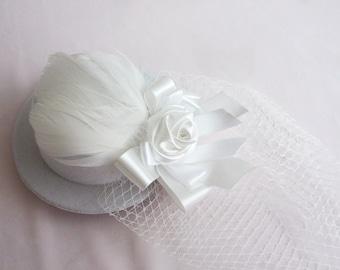 white feather head piece hat