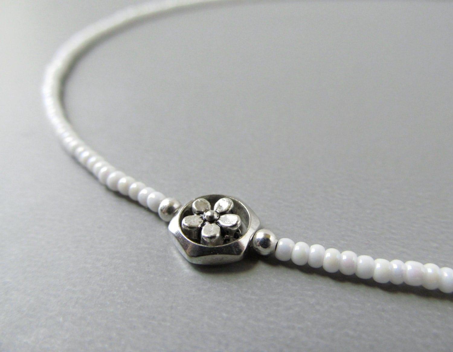 beaded eyeglass chain with silver flowers reading by halfsnow
