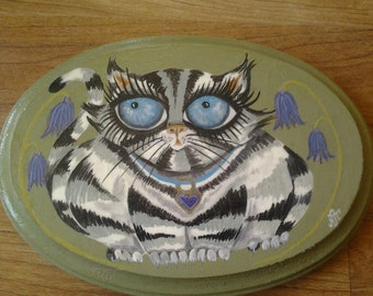 Silver tabby cat and bluebells. Acrylic painting on wood