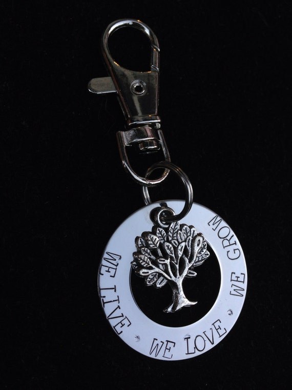 Personalized Key Chain with tree. Hand stamped with 'we live • we love • we grow'