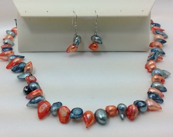 gator tooth pearl necklace and earrings set.