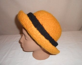 100% Wool, felted knit, woman's hat. Goldenrod with black hat band.