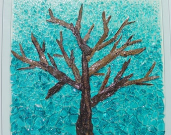 SOLD! Winter Solstice- Simply organic, this piece was made on a glass table top, a solitary tree made from tree bark and blue glass.