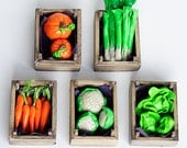 Miniature wooden crate with vegetables.