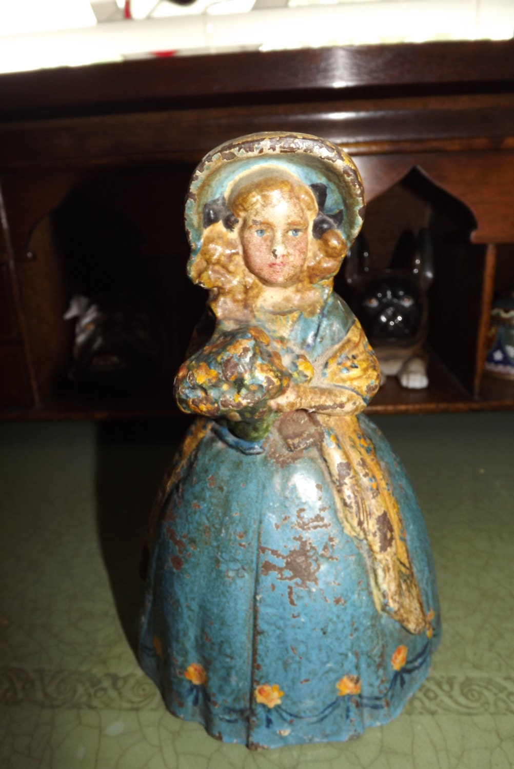 Figural Antique Cast Iron Door Stop Lady With Flowers And