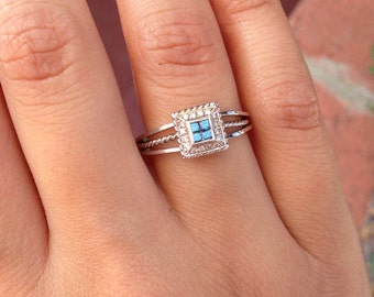 14K White Gold Ring with Blue Diamonds