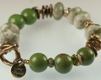 Greenpeace Bracelet - peace stone, porcelain, serpentine, crystal and bronze
